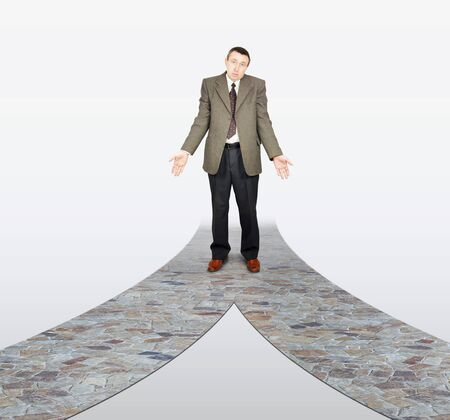 fork in the road: Frustrated businessman at the road fork. Concept of difficult choice