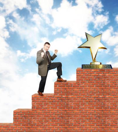 Joyful man going upstairs to the reward. Way to success photo