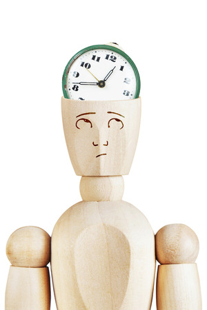 tardiness: Alarm clock in the human head. Time trouble. Abstract image with a wooden puppet Stock Photo