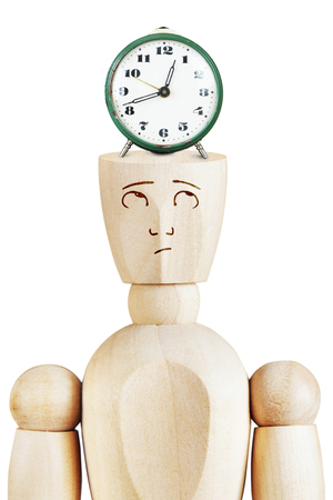 time pressure: Alarm clock on the human head. Time pressure. Abstract image with a wooden puppet Stock Photo