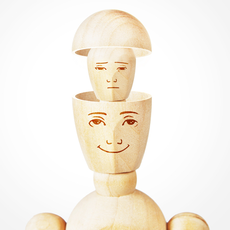 Split personality. Psychological problems. Abstract image with a wooden puppet Stock Photo