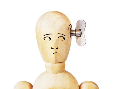 marioneta de madera: Man with turning handle in his head. Abstract image with a wooden puppet