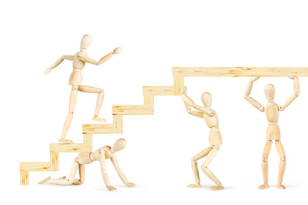 careerist: Men supporting stairs and other man going up. Abstract image with wooden puppets