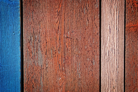Old flaking multi colored painted wooden background
