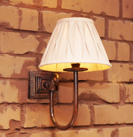 sconce: Lamp on the brick wall Stock Photo