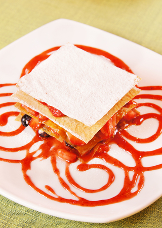 layered: Millefeuille Layered dessert  with fresh berries