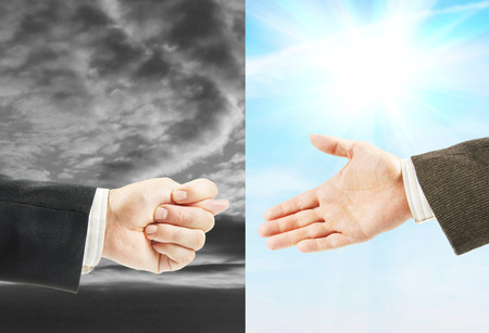 refusal: Man shows a fig in response to the offered hand. Concept of betrayal