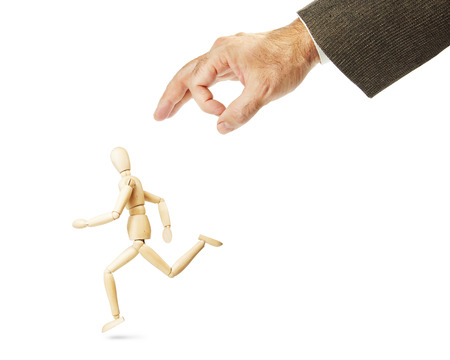 marioneta de madera: Man runs away from hitting. Abstract image with a wooden puppet