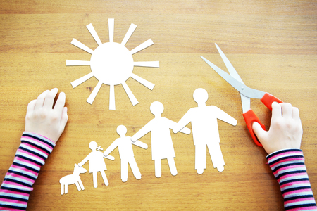 fantasize: Little girl fantasizing about amicable large family. Conceptual image with paper scrapbooking