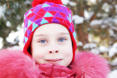 Portrait of a little pretty girl wearing pink clothes outdoor