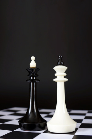 chessman: Two chess kings. Battle of equal rivals. Concept with chess pieces against black background Stock Photo