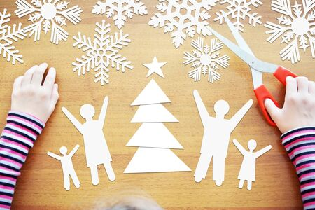 Little girl dreams about winter holidays together with full family. Concept with paper scrapbooking