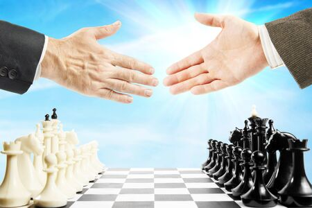 fair play: Handshake before the chess game. Concept of fair play and mutual respect