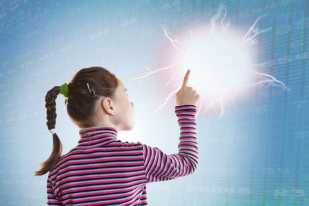 Little girl touching a clot of energy. Conceptual image about new technologies