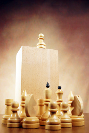 Impostor. Chess pawn on the top. Conceptual image with chess pieces