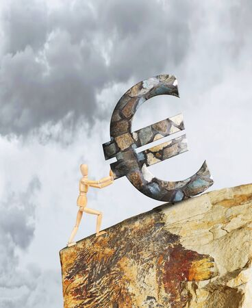 steep cliff sign: Man holding the Euro from falling down a cliff. Abstract image with a wooden puppet Stock Photo