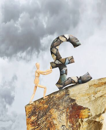 steep cliff sign: Man holding the Pound from falling down a cliff. Abstract image with a wooden puppet Stock Photo