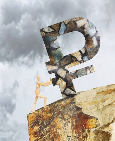 Man holding the Ruble from falling down a cliff. Abstract image with a wooden puppet Stock Photo