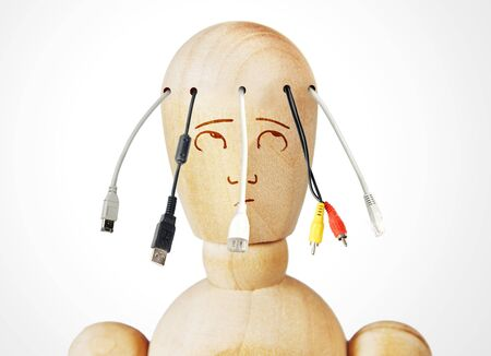 marioneta de madera: Man with various cables for connection coming from his head. Abstract image with a wooden puppet
