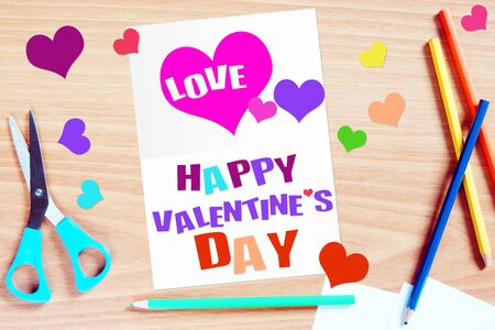 Handmade greeting with Valentine day. Conceptual image with paper scrapbooking