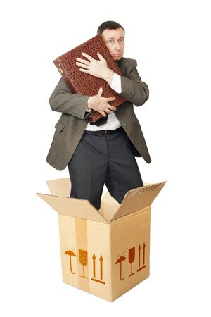 Clerk with a suitcase appears out from the cardboard box. Isolated over white photo