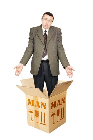 bewilder: Ordinary man appears out from the cardboard box. Isolated over white Stock Photo