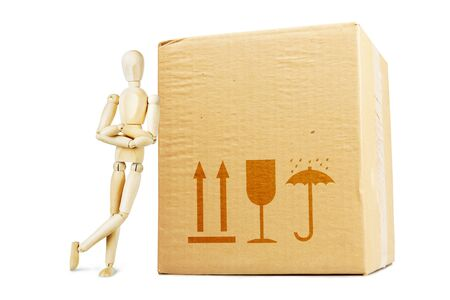 marioneta de madera: Man leaning on a huge parcel. Abstract image with a wooden puppet
