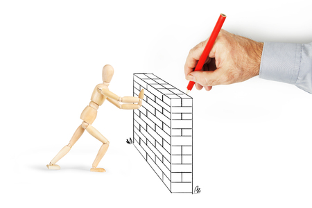 Man draws a wall and makes obstacles for other person. Conceptual image with pencil drawing