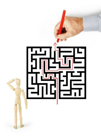 entanglement: Man shows to other person way through the labyrinth. Abstract image with a wooden puppet
