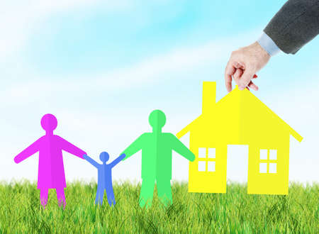 Concept of providing a young happy family with own housing. Colorful scrapbooking against blue sky