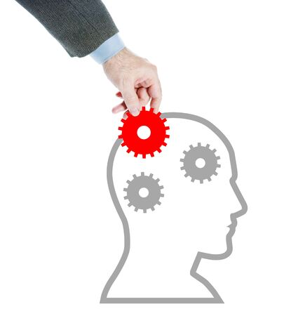 psychics: Man puts missing cogwheel in the human head. Abstract conceptual image isolated over white background Stock Photo