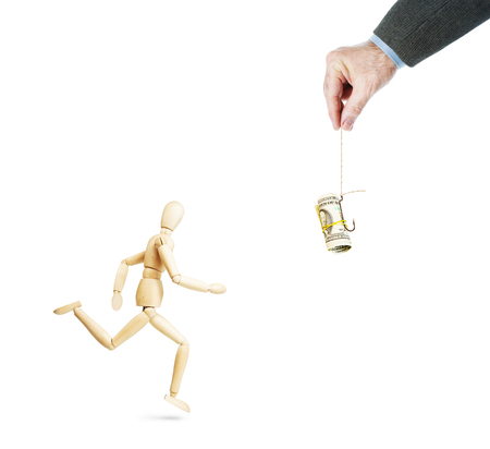 Man running for dollar banknotes on the fishing hook. Abstract conceptual image with a wooden puppet Stock Photo