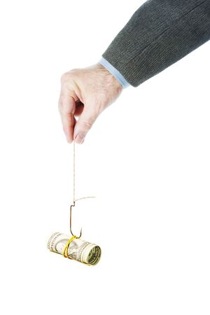 Man holds a fishing hook with dollar banknotes as a bait. Isolated over white background