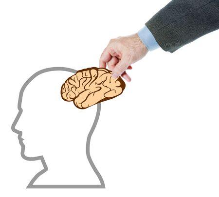 psychics: Man puts a brain into human head. Abstract conceptual image