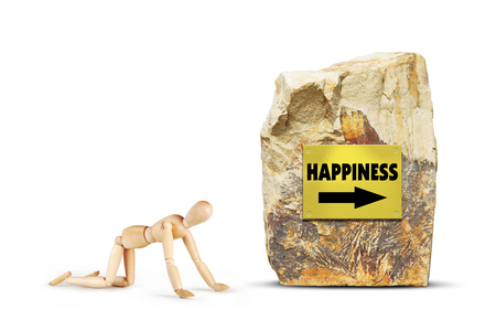 Tired man creeps towards happiness. Abstract image with a wooden puppet
