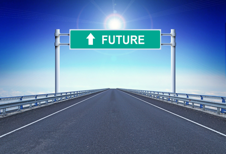 Straight highway with a text Future on the road sign. Concept of movement forward Stock Photo