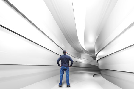 Man stands in a  tunnel with a turn into the unknown Stock Photo