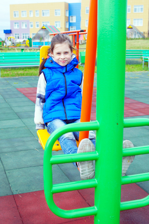 White ten years old girl is engaged in sports simulators on a sports ground outdoor