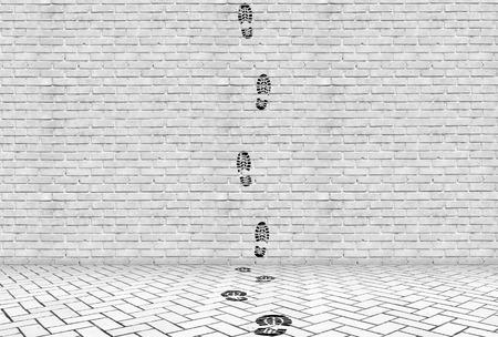Footprints going upwards on a high brick wall