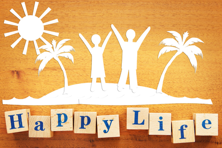 Happy Life and a Vacation. Concept with scrapbooking on a wooden desk