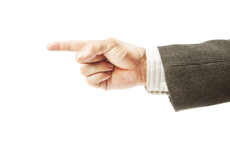 Male hand in a suit points with his finger aside isolated on white background Imagens