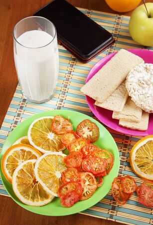 Breakfast with milk and fruit chips and crispbreads. Healthy vegetarian dietary food