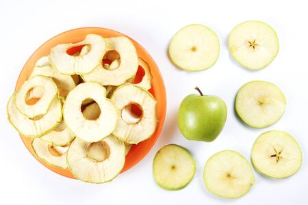 Ingredients for fruit chips made of apples on white background. Healthy vegetarian dietary food
