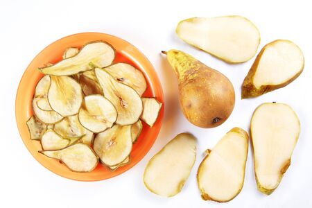 Ingredients for fruit chips made of pears on white background. Healthy vegetarian dietary food