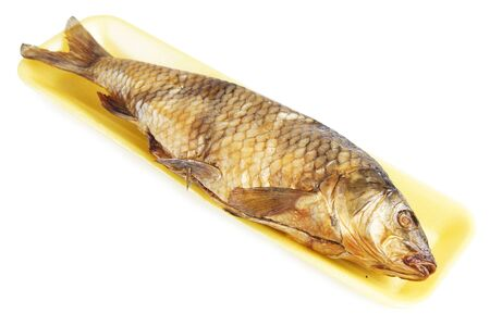 Smoked ide fish in a yellow plastic tray isolated on white background Banco de Imagens