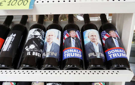 RIMINI, ITALY, SEPTEMBER 23, 2019. Wine bottles with labels with portraits of Putin and Trump and Mussolini sold as souvenirs