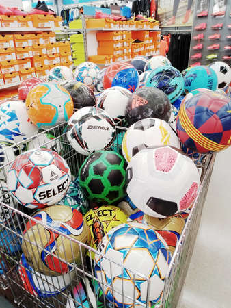 KEMEROVO, RUSSIA, MAY 10, 2020. A lot of various football balls sold at a sports store