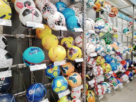 KEMEROVO, RUSSIA, MAY 10, 2020. Many various football balls sold at a sports store