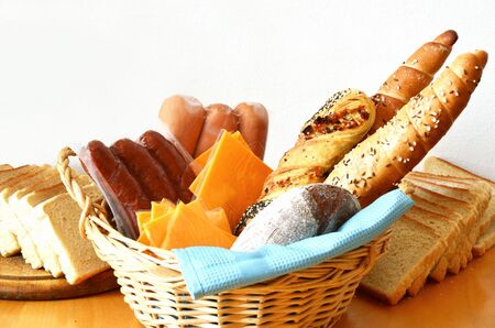 breads, sausages and cheese on white background