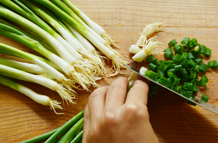cutting boards: spring onions with wooden cutting boards